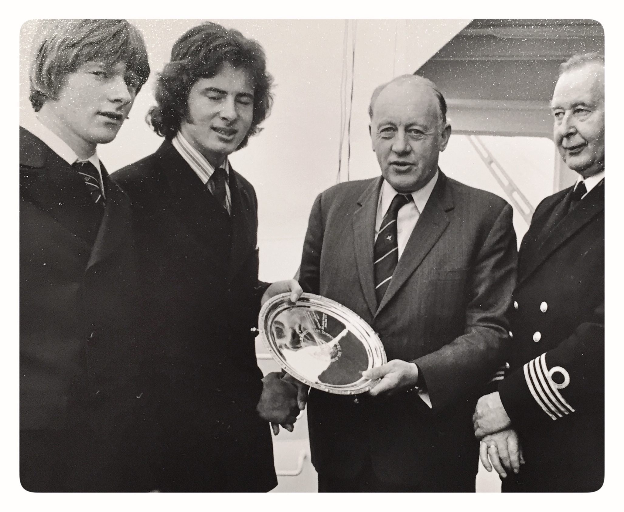 Patrick Jameson presentes Joe English with the ISA Junior Helmsman's Trophy in 1974 - Left to right: Nei Keneflick, Joe English, Patrick Jameson and the Captain of the RV Tyro, from which the trophy was presented each year in Dublin Port