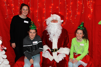 More of the Elves - Kate, Ella and Sarah with Santa