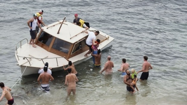 The race committee boat is rescued from a nudist beach!