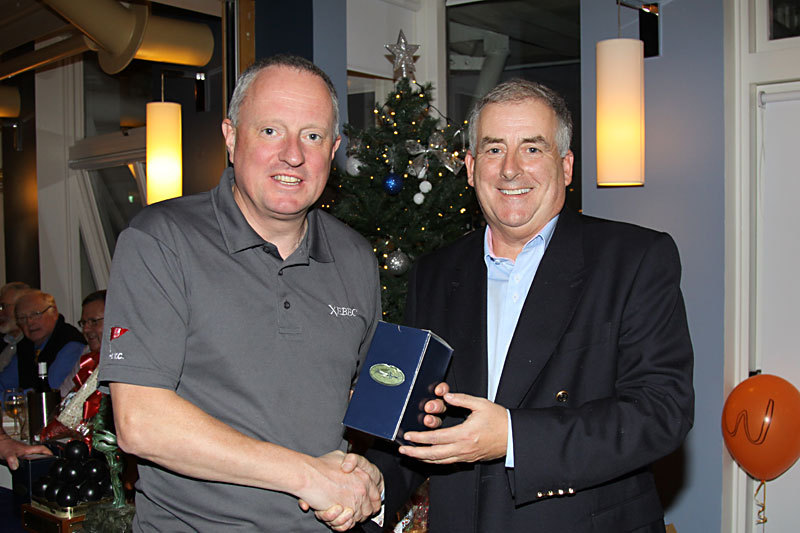 Eddie Bourke (Xebec) receives his prize from Commodore Joe McPeake