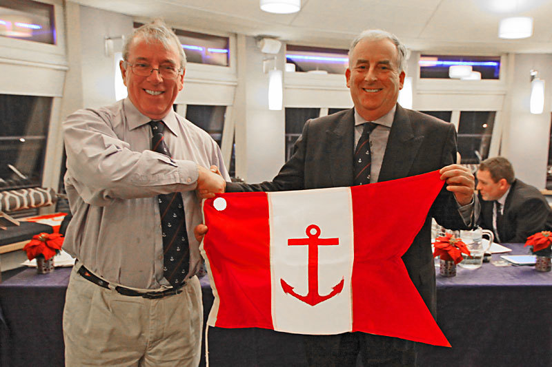 Ian Byrne receives his Vice Commodore's Flag from Commodore Joe McPeake