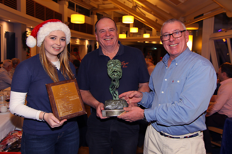 Jennie and Stephen Harris are presented with the Lorna Townsend Trophy by Commodore Ian Byrne